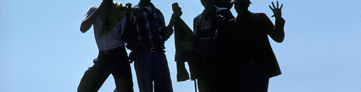 silhouetted men posing